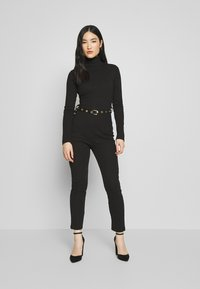 Missguided - HIGH NECK BELTED LONG SLEEVE - Jumpsuit - black - 1