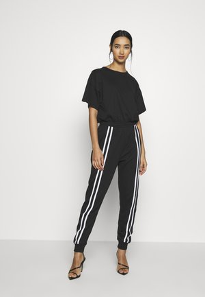 LOOPBACK SPORTS STRIPE - Tuta jumpsuit - black