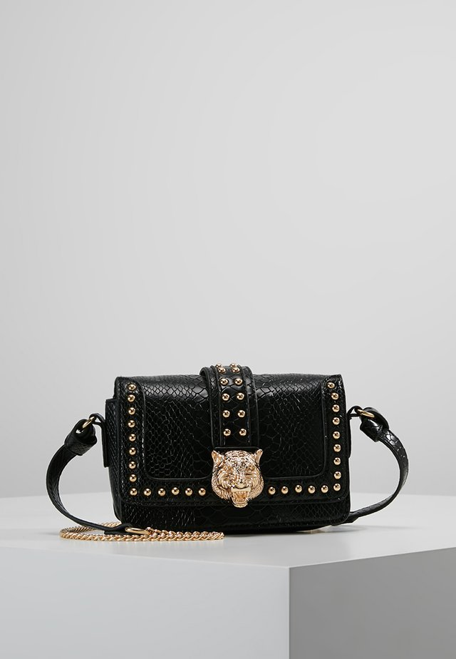LION HEAD CROSS BODY BAG - Umhängetasche - black