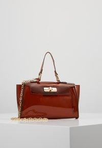 Missguided - TRANSPARENT MINI HANBAG - Handbag - brown - 0