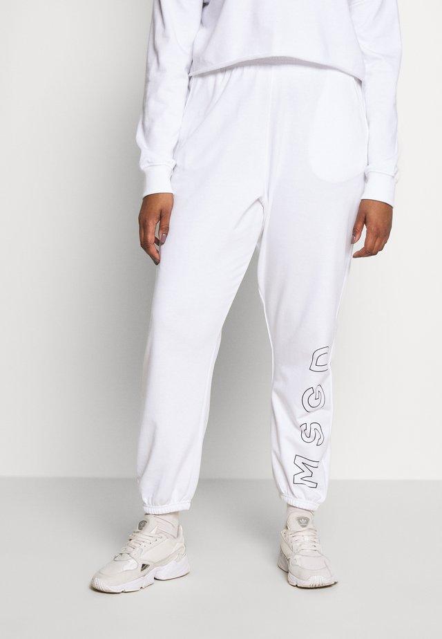 SLOGAN JOGGERS - Teplákové kalhoty - white