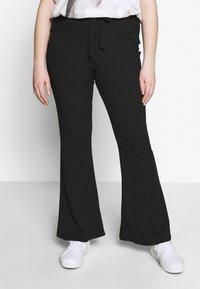 Missguided Plus - PLUS FLARE TIE BELT TROUSER - Trousers - black - 0