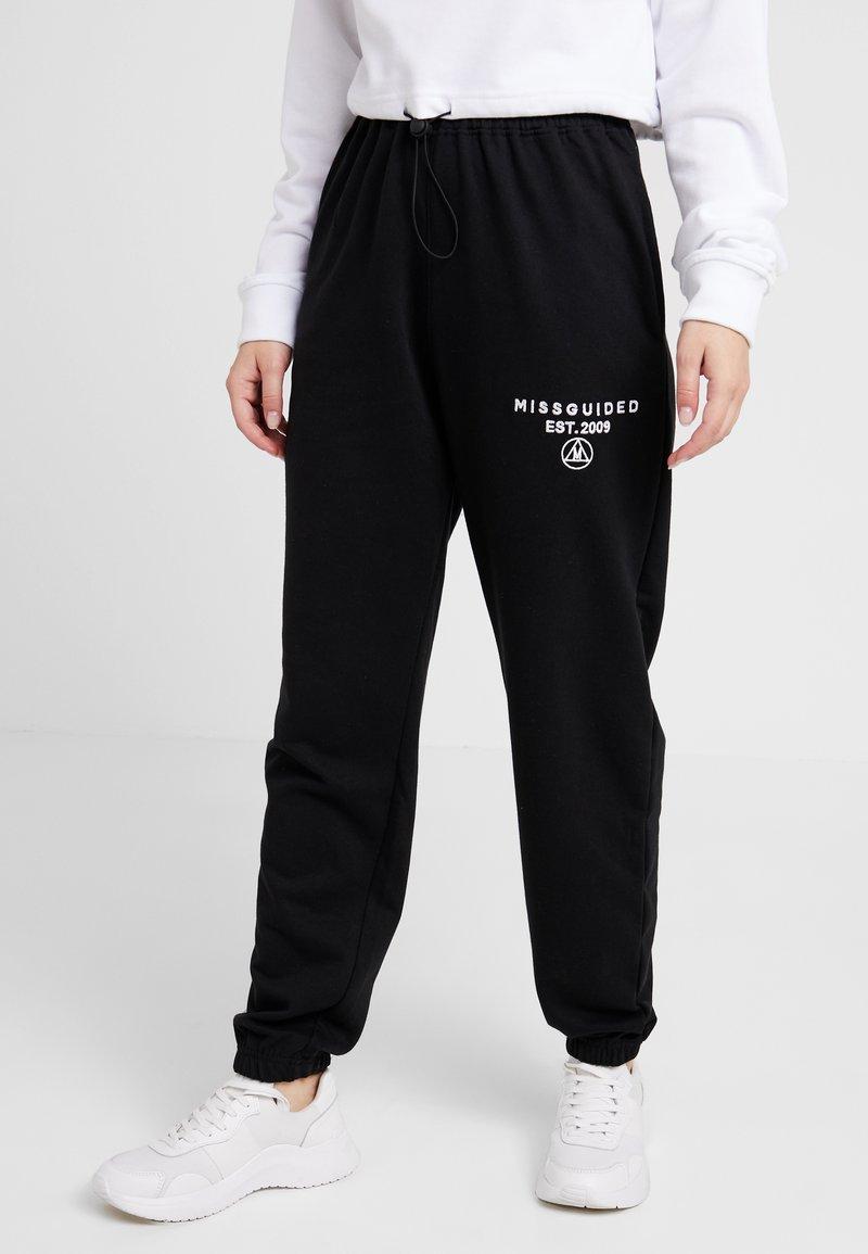 Missguided Petite - SLOGAN - Pantalon de survêtement - black