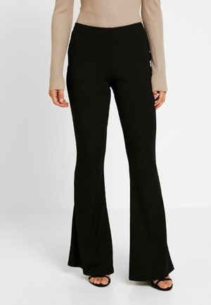 FLARE TROUSER BLACK - Kangashousut - black