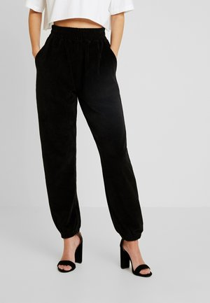 CUFFED - Pantalones deportivos - black