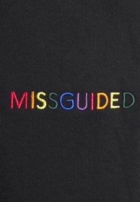 Missguided Petite - PRIDE JOGGERS - Pantalones deportivos - black - 5
