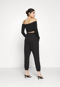 Missguided Petite - PRIDE JOGGERS - Pantalones deportivos - black - 2