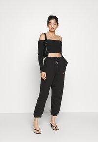 Missguided Petite - PRIDE JOGGERS - Pantalones deportivos - black - 1
