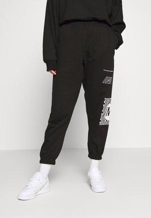 GRAPHIC - Pantalones deportivos - black