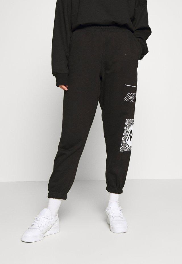 GRAPHIC - Spodnie treningowe - black