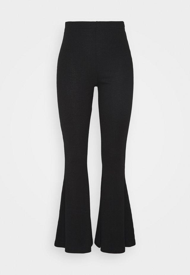 PETITE RIBBED LEGGING KICK FLARE - Pantalon classique - black
