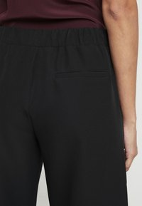 Moss Copenhagen - DUNA PANTS - Pantalones - black - 3