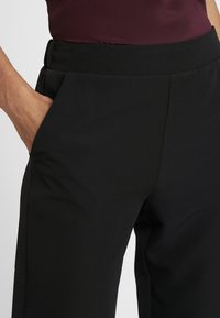 Moss Copenhagen - DUNA PANTS - Pantalones - black - 5