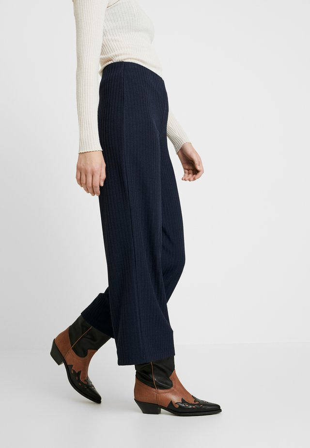 JENNIE ANKLE PANTS - Trousers - outer space