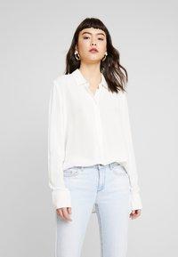 Moss Copenhagen - CADDY BEACH - Button-down blouse - egret - 0
