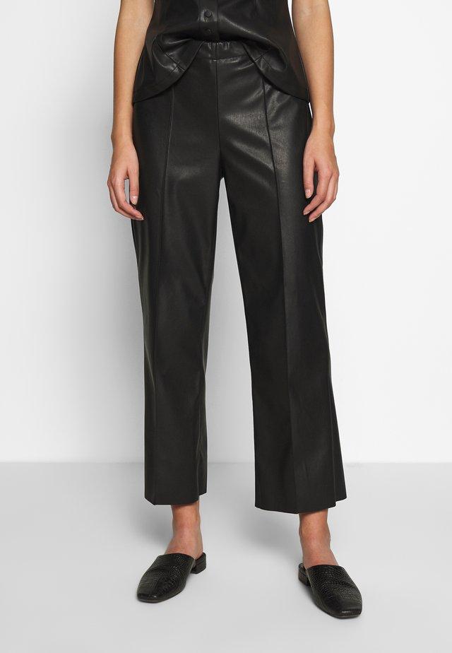 NEW SKIN PIRLA - Spodnie materiałowe - black