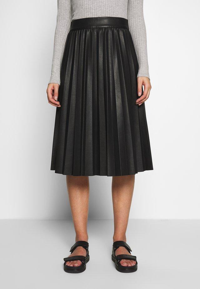NEW SKIN STELPA - Áčková sukně - black