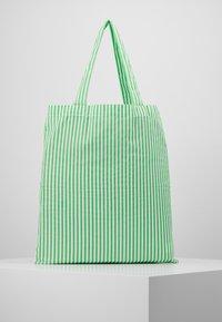 Mads Nørgaard - ATOMA - Tote bag - white/green - 2