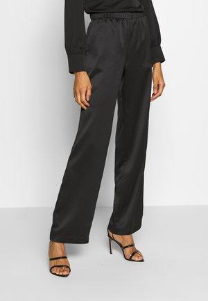 PAVIA - Trousers - schwarz