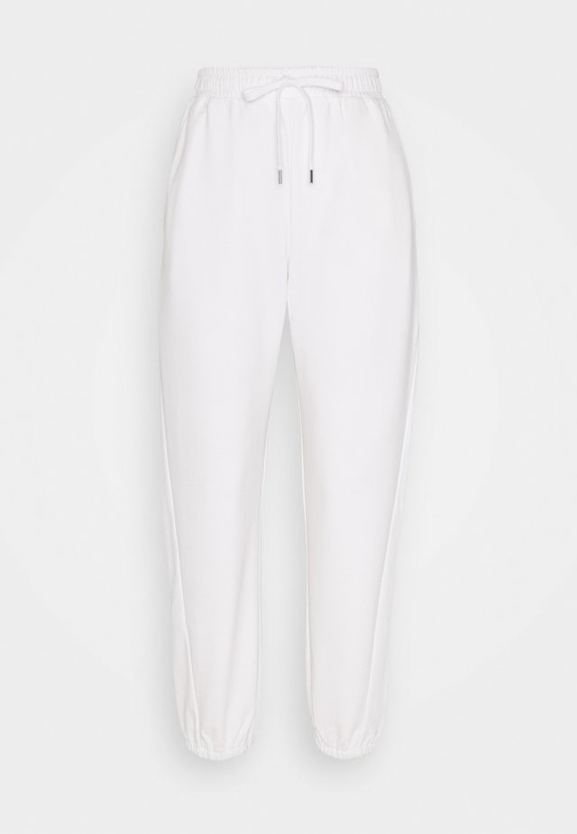 LEMBI - Tracksuit bottoms - white