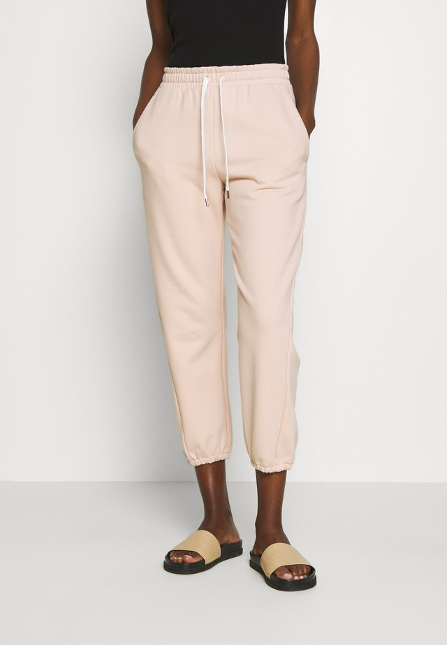 LEMBI - Teplákové kalhoty - puder