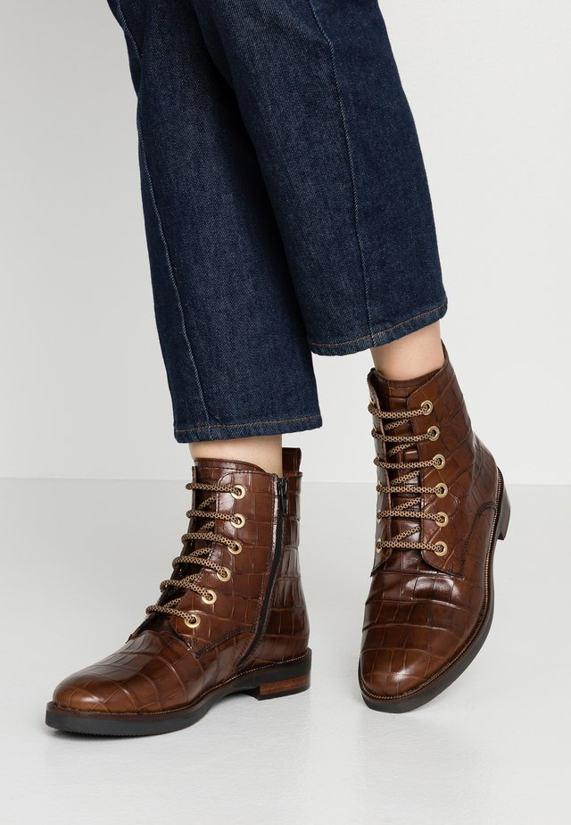 Lace-up ankle boots - moira rovere