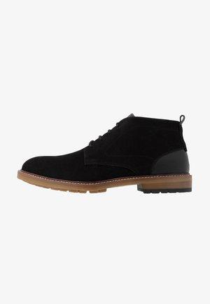 MONTAG - Volnočasové šněrovací boty - black