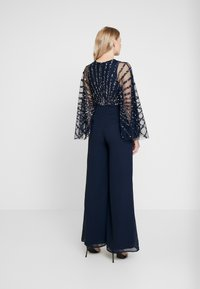 Maya Deluxe - STRIPE EMBELLISHED WITH CAPE SLEEVES - Jumpsuit - navy - 2