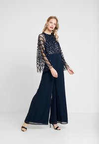 Maya Deluxe - STRIPE EMBELLISHED WITH CAPE SLEEVES - Jumpsuit - navy - 1