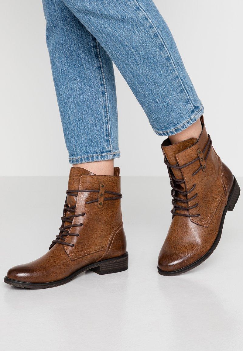 Marco Tozzi - Lace-up ankle boots - cognac antic