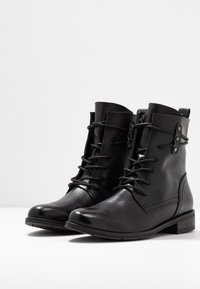 Marco Tozzi - Lace-up ankle boots - black antic - 4