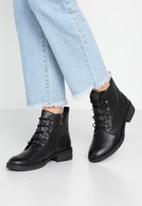 Marco Tozzi - Ankle boots - black antic - 0