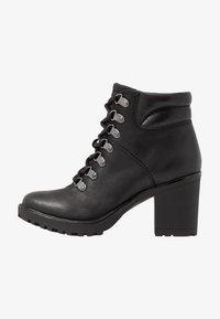 Marco Tozzi - Kotníková obuv - black - 1