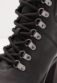 Marco Tozzi - Kotníková obuv - black - 2