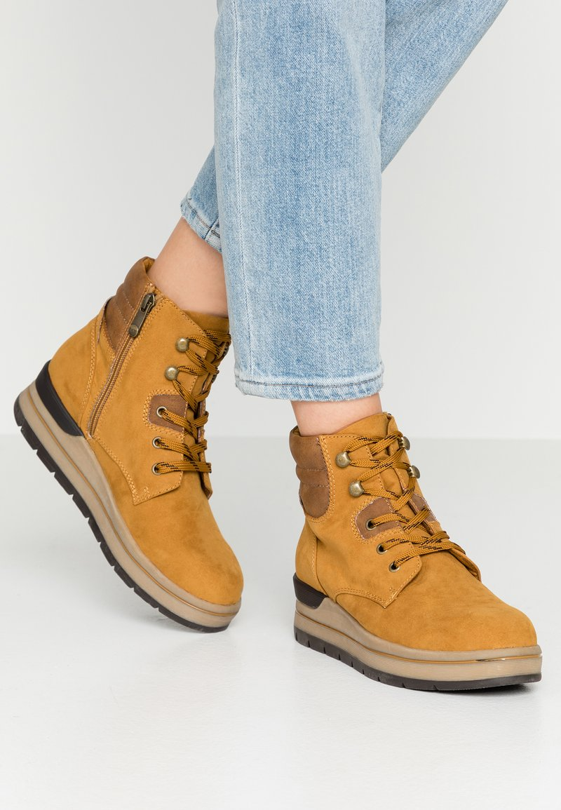 Marco Tozzi - Ankle boots - mustard
