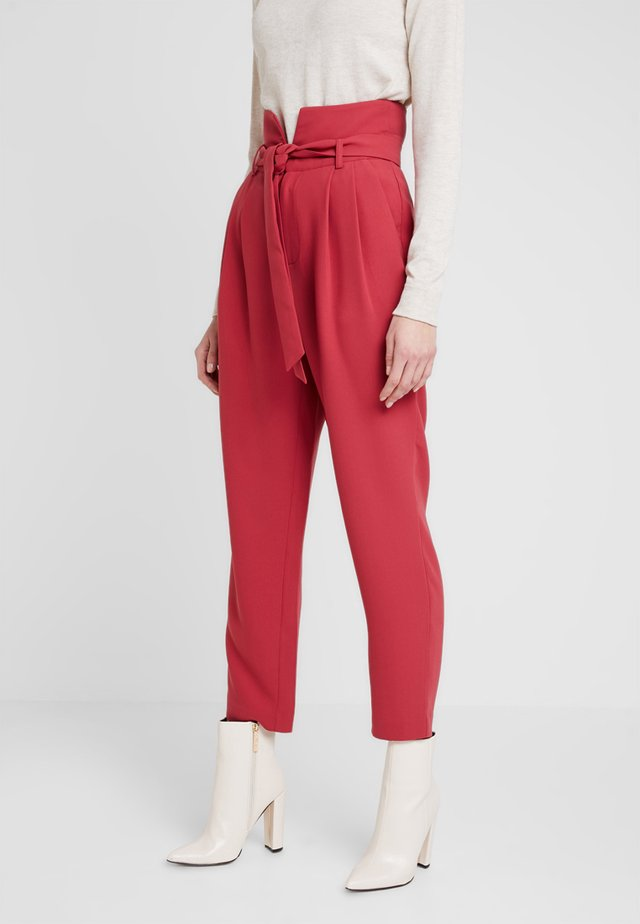 Trousers - earth red