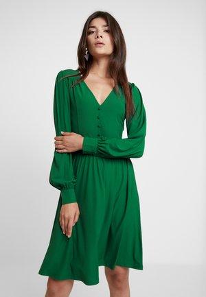 Vestito di maglina - green
