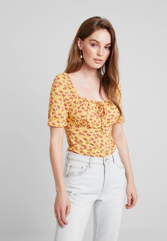 Print T-shirt - dark yellow