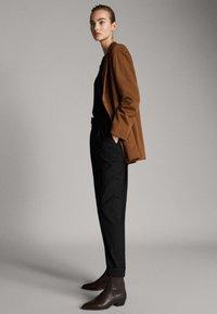 Massimo Dutti - Tracksuit bottoms - black - 3