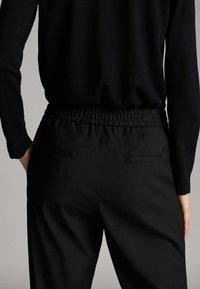 Massimo Dutti - Tracksuit bottoms - black - 5