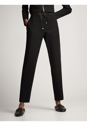 MIT STRUKTURMUSTER - Trousers - black