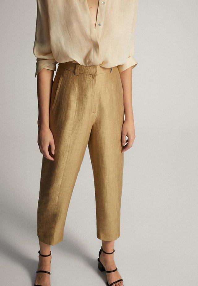 Spodnie materiałowe - gold