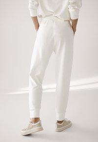 Massimo Dutti - Tracksuit bottoms - white - 2