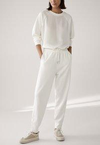 Massimo Dutti - Tracksuit bottoms - white - 1