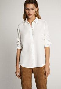 Massimo Dutti - UNIFARBENES HEMD AUS REINEM LYOCELL 05139571 - Button-down blouse - white - 0