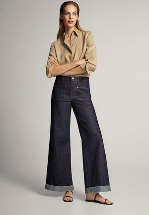 MIT HOHEM BUND  - Jeans a zampa - dark blue
