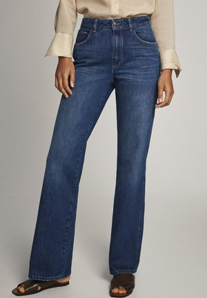 MIT SCHLAG UND HOHEM BUND - Flared Jeans - blue