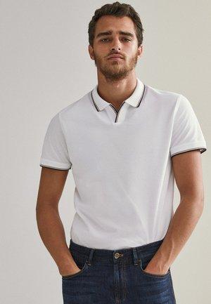 KURZÄRMELIGES  - Polo shirt - white