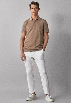 MIT KONTRASTBIESEN - Polo shirt - beige