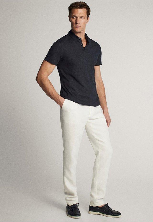 KURZÄRMELIGES - Polo shirt - blue-black denim